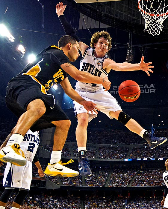 VCU point guard Joe Rodriguez angles a pass by Butler's Matt Howard during the 2011 NCAA Tournament. Both the Rams and Bulldogs earned surprise berths in the Final Four, though UConn cut down the nets on April 4.