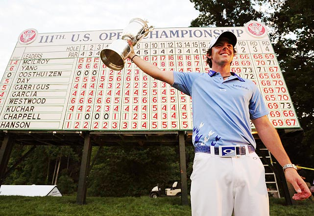 Rory McIlroy hoists his first PGA Major trophy after winning the 2011 U.S. Open in June. The Northern Ireland native finished eight strokes ahead of the second-place finisher, Jason Day.