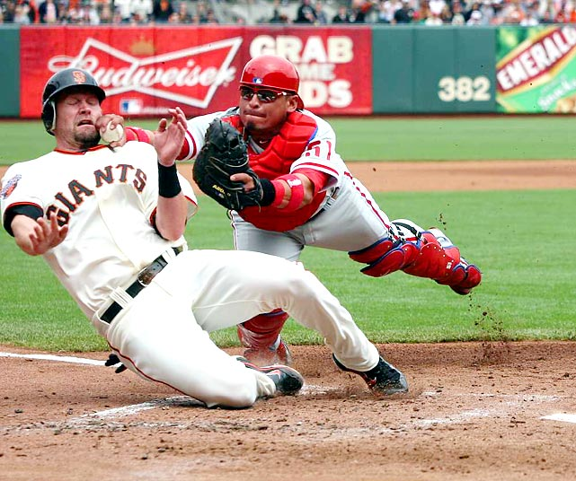 Phillies catcher Carlos Ruiz dives to tag out Aubrey Huff during their regular season game on Aug. 7. San Francisco won 3-1, but failed to repeat as World Series -- or National League West -- champions.