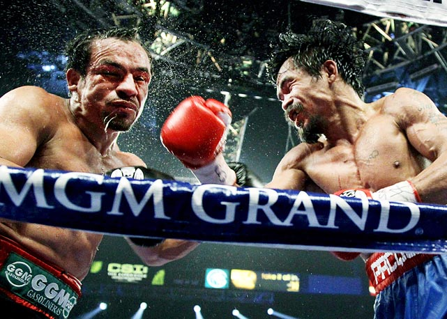 Manny Pacquiao connects on a right hook during his WBO welterweight title fight against Juan Manuel Marquez. The Filipino star won by majority decision in November.