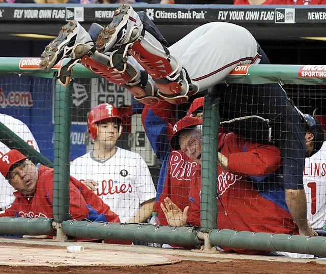 Philadelphia manager Charlie Manuel dodges a tumbling Brian McCann during a game against the Braves on May 6. The Braves won 5-0, but missed out on a playoff berth after being swept by the Phillies in their final series of the season.