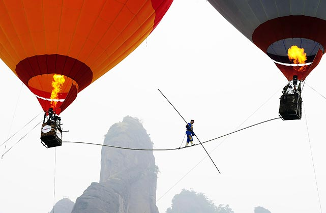 Saimaiti Aishan, a 27-year-old Chinese acrobat, becomes the first person to tightrope walk between two hot air balloons on Aug. 6. Aishan set a national tightrope walking record at 30 meters, but failed during his 100 meter attempt, it was reported.