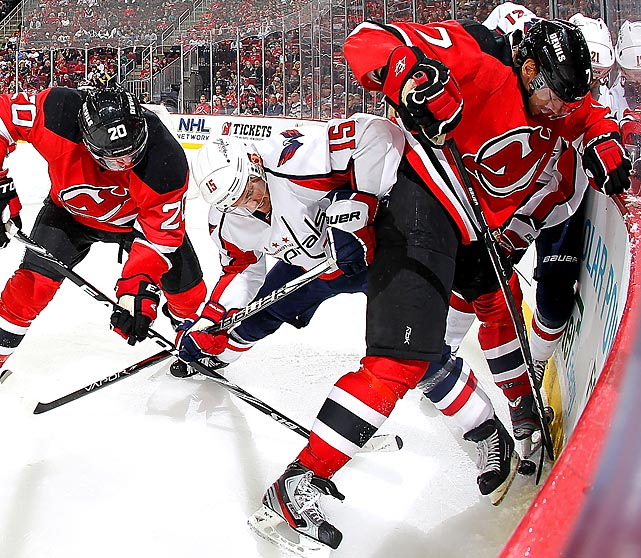 Capitals' center Jeff Halpern (15) and Devils' defenseman Henrik Tallinder (7) fight for the puck along the boards during a 3-1 Washington win in November. Alex Ovechkin, Jason Chimera and Marcus Johansson scored goals in the game.