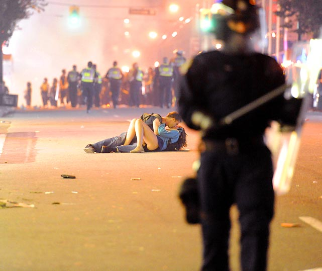 If a picture is worth 1,000 words, this one may be worth a million. Scott Jones kisses his girlfriend, Alex Thomas, during the Vancouver riot following the 2011 Stanley Cup Finals.