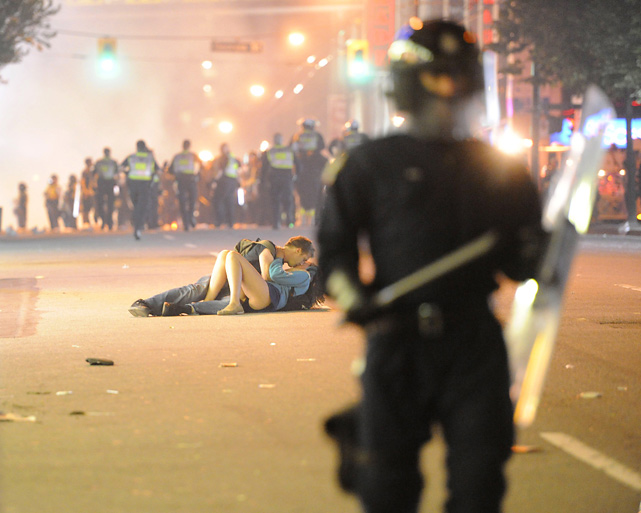 Scott Jones consoles his girlfriend, Alex Thomas, with a kiss during the riot in Vancouver that followed the Canucks' loss in Game 7 of the 2011 Stanley Cup Finals. This image was chosen by  Sports Illustrated  as its photo of the year.