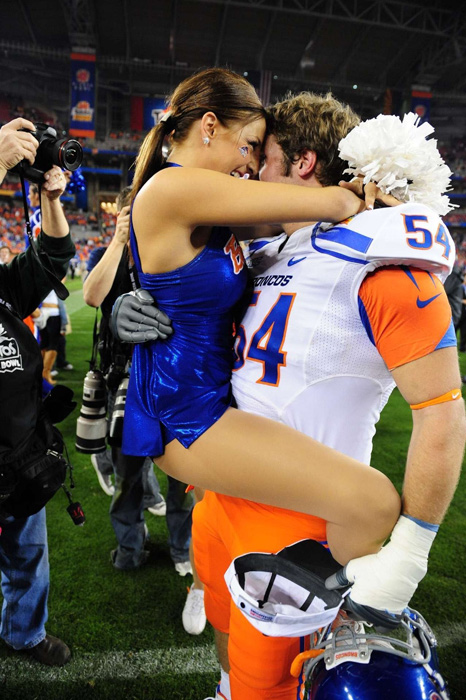 Boise State offensive lineman Michael Ames proposes to his girlfriend and team cheerleader Tess Tracey after the 2010 Fiesta Bowl against TCU. He wasn't the first Bronco to propose after the Arizona bowl game.