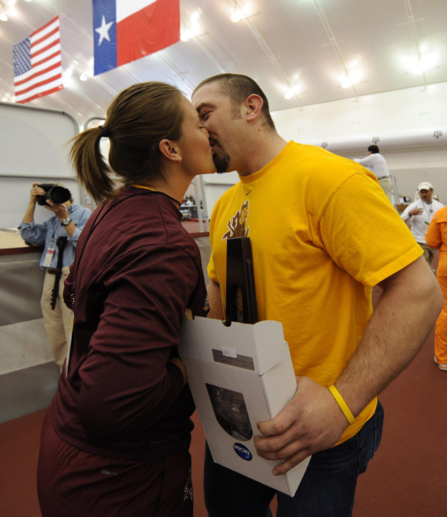 Ross Walker kisses Arizona State shot putter Ross Walker after proposing to her at the 2009 NCAA Indoor Championships.