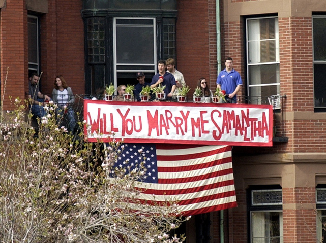 A sign along Commonwealth Avenue in Boston proposes marriage to one of the 106 runners participating in the 2002 Boston Marathon.