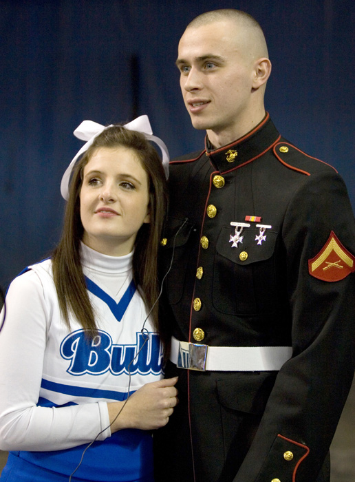 Lance Corporal Mike Neisen proposed to his girlfriend Eve Solomon, a University of Buffalo cheerleader, before he was sent to California to begin training for duty in Iraq.