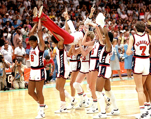 Summit gets carried off the court by USA Olympic players after America defeated South Korea in the gold medal game. Summit also won a Silver medal as a player in the 1976 Olympics.