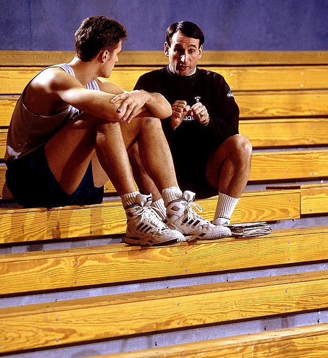 Krzyzewski talks to Duke forward Christian Laettner during a 1992 basketball practice. Laettner, the only college player ever to start in four Final Fours, helped Krzyzewski win NCAA titles in 1991 and 1992.