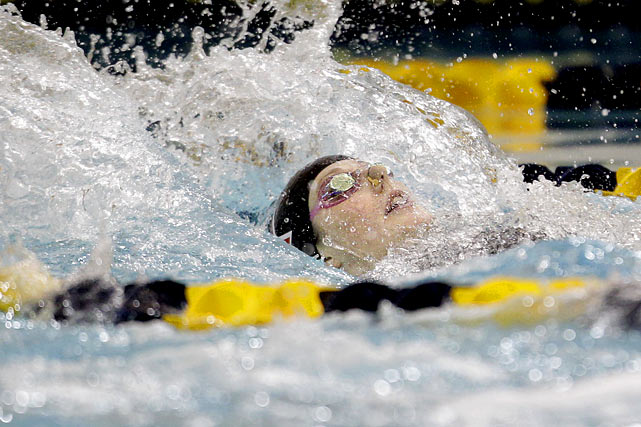 Missy Franklin cuts through the water on her way to a gold medal in the women's 100-meter backstroke on Friday Dec. 2. Franklin finished the weekend with the women's high point award.