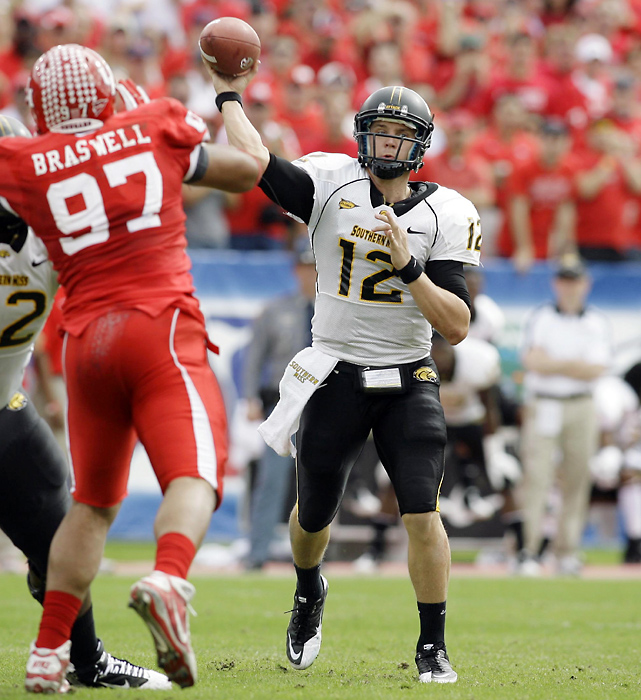 Quarterback Austin Davis (pictured) threw four touchdown passes as Southern Miss shocked the Cougars, wrecking their perfect season and chance at a BCS bowl bid.