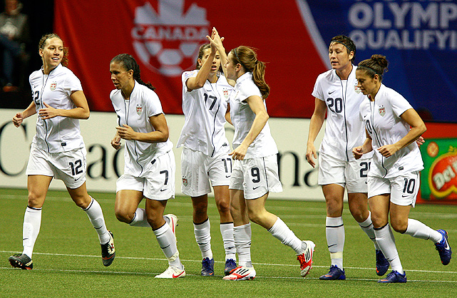 U.S. celebrates a goal by Heather O'Reilly against the Dominican Republic.
