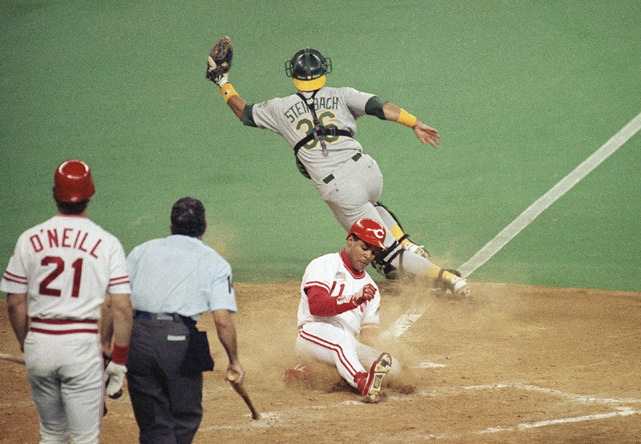 Larkin slides safely home in Game 1 of the 1990 World Series. The nine-time Silver Slugger Award winner batted .353 in the Series to help the Reds sweep the heavily-favored A's.