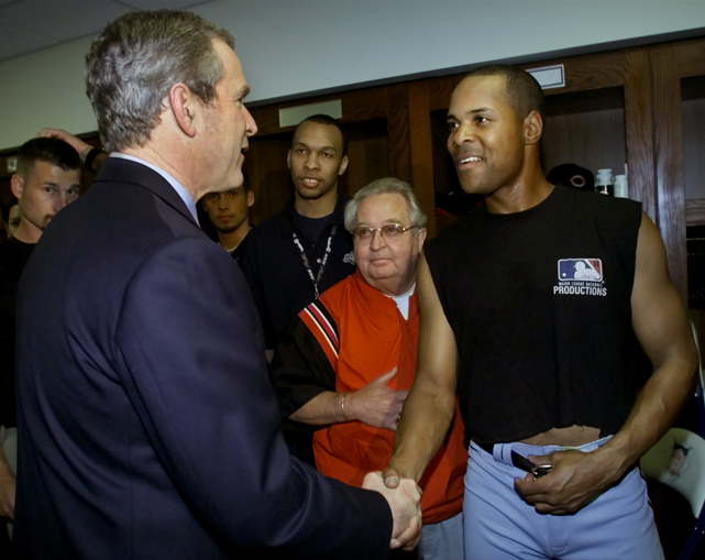 Larkin shakes hands with President George W. Bush before Bush threw out the first pitch at Milwaukee's Miller Park in April 2001.