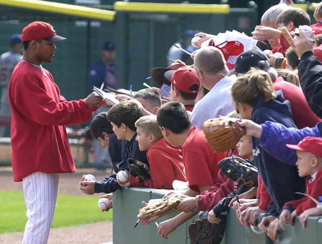 Larkin signs autographs before a game against Montreal in September 2003. The Cincinnati-native played with his hometown Reds from 1986 to 2004.
