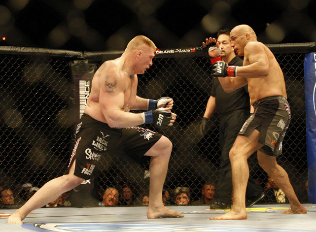 Lesnar moves to take down Randy Couture during the Heavyweight Championship fight at UFC 91 in November 2008. Lesnar beat Couture via technical knockout to become the UFC Heavyweight Champ.