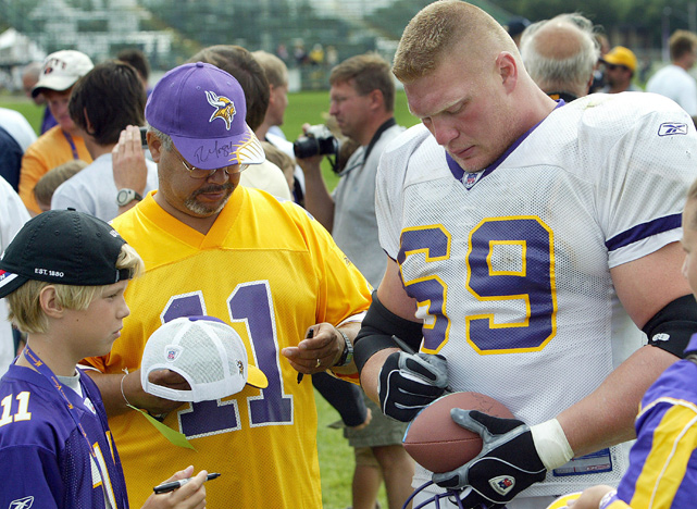 Lesnar signs autographs after Minnesota Vikings training camp in Makato, Minn. in August 2004. Lesnar put his pro wrestling career on hold to try out for the Vikings, who ended up cutting him late in training camp.