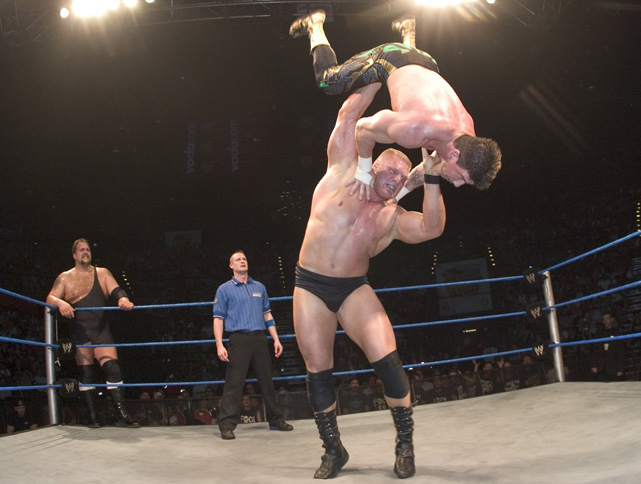 Lesnar throws Eddie Guerrero to the mat during an Aug.  2004 WWE match.