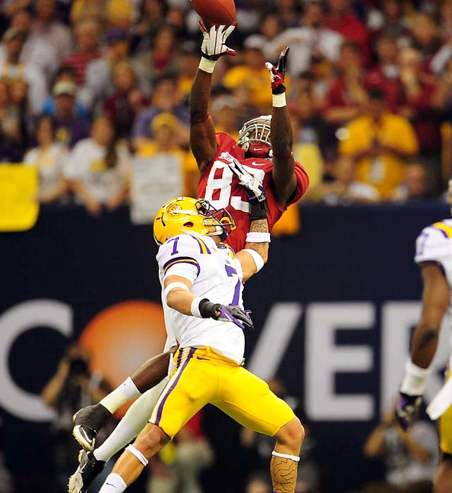 Kevin Norwood makes a leaping catch over the famed Honey Badger.