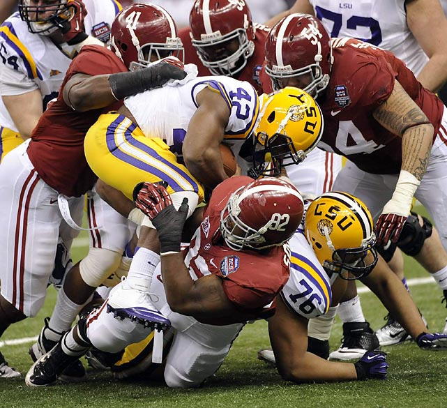 Michael Ford, part of LSU's four-headed running back attack, goes head-to-head with Alabama's bruising defense.