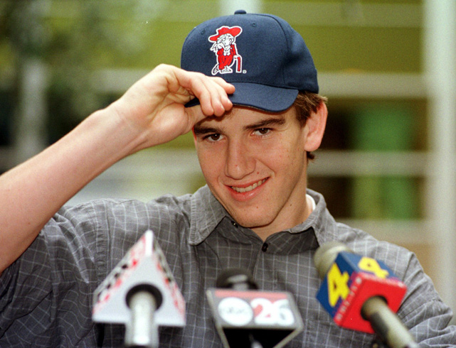 Manning dons an Ole Miss cap after choosing to follow in his father's footsteps and play college football for the Rebels.