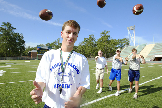 Archie, Peyton and Eli throw at eldest brother Cooper Manning during the 2003 Manning Passing Academy camp.