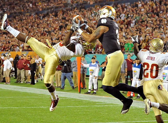 Notre Dame wide receiver Michael Floyd (3) makes a touchdown catch over Florida State cornerback Greg Reid in the second half at the Champs Sports Bowl.