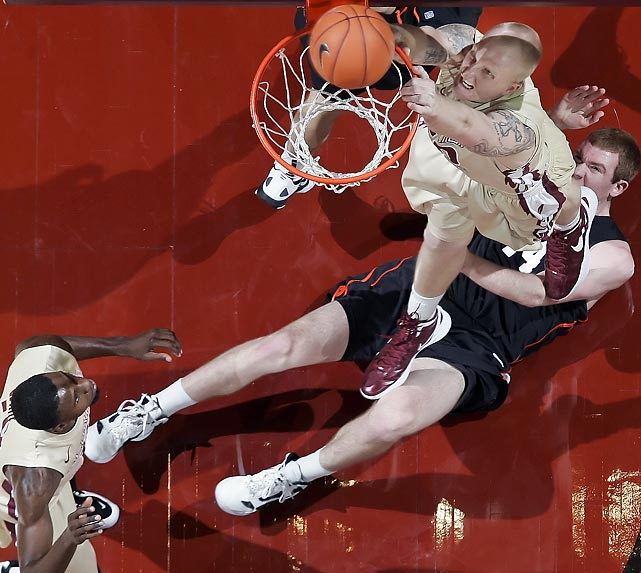 Florida State center Jon Kreft misses a dunk while Princeton forward Ian Hummer lies defenseless.