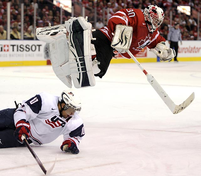 Canada's goalie Scott Wedgewood goes airborne after colliding with Team USA's Emerson Etem during the IIHF U20 World Junior Hockey Championships in Edmonton, Alberta.
