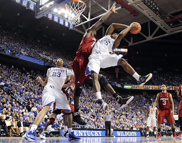 Marquis Teague of Kentucky attempts a twisting shot against Louisville's Gorgui Dieng.  Kentucky won 69-62.
