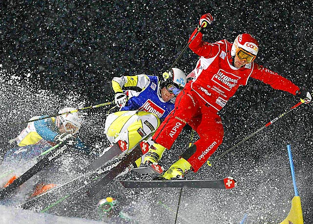 Switzerland's Armin Niederer (right), Canada's Christopher Del Bosco (center) and Austria's Patrick Koller (left) compete in a Ski Cross World Cup event.