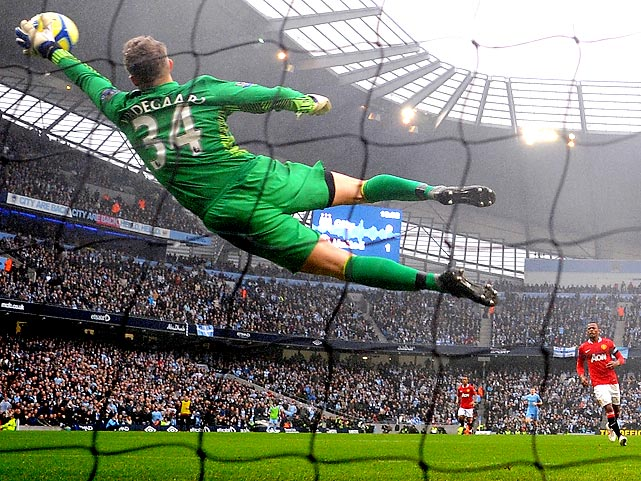 Manchester United goalie Anders Lindegaard stretches to save Manchester City forward Sergio Aguero's shot during the sides' FA Cup third-round match on Sunday. United beat 10-man City 3-2.