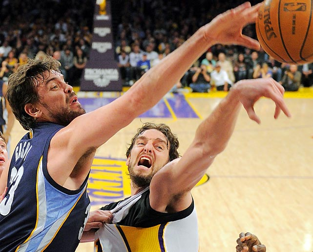 Brothers Marc (left) and Pau Gasol fight for a rebound in the first half of Friday's game between Memphis and Los Angeles at the Staples Center. Big brother Pau and the Lakers won 90-82.