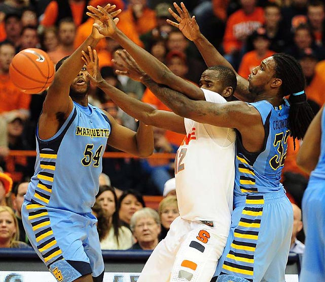Syracuse center Baye Moussa Keita fights for a loose ball with Marquette's Jae Crowder and Davante Gardner. The top-ranked Orange beat No. 20 Marquette 73-66 to improve to 17-0.