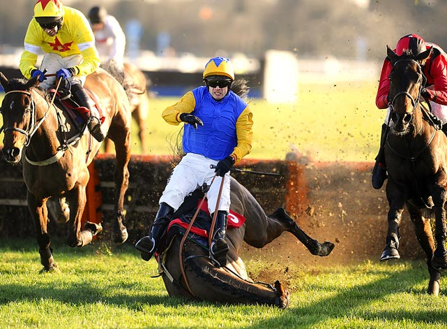 Jockey Sam Thomas falls with his horse, Captain Sunshine, in a race in Sunbury, England.