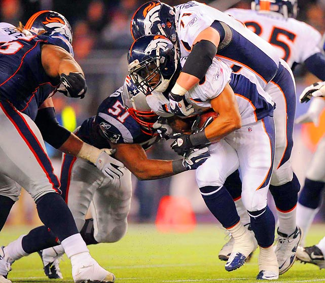 New England linebacker Jerod Mayo tackles Denver running back Jeremiah Johnson in the Patriots' blowout win over the Broncos on Saturday.