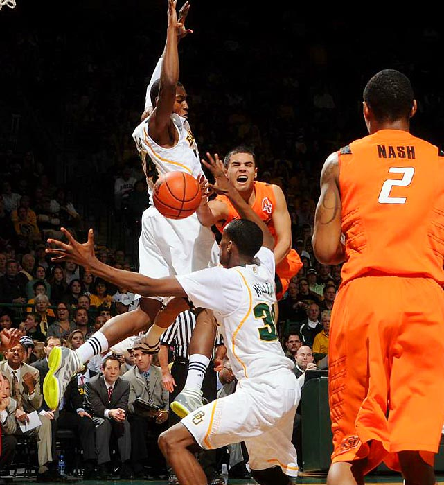 Oklahoma State's Cezar Guerrero attempts to pass to teammate Le'Bryan Nash in Baylor's blowout win over the Cowboys.