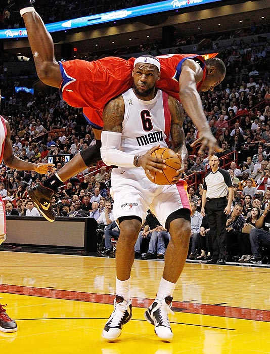 LeBron James draws a hard foul against Philadelphia's Elton Brand.