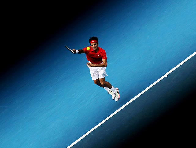 Roger Federer hits a serve in his third-round win at the Australian Open.