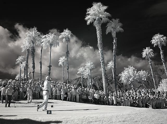 Former President Bill Clinton -- seen here in an infrared photo -- hits a tee shot during the third round of the Humana Challenge.