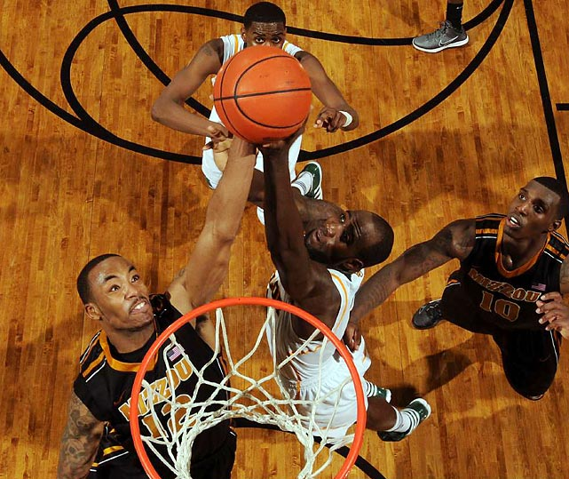 Mizzou's Marcus Denmon battles for a rebound with Baylor big Quincy Acy in the Tigers' 89-88 win in Waco.