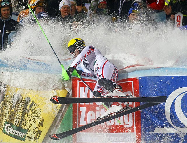 Marcel Hirsher of Austria crashes into a barrier after winning the Alpine Skiing World Cup Slalom race in Schladming, Austria.