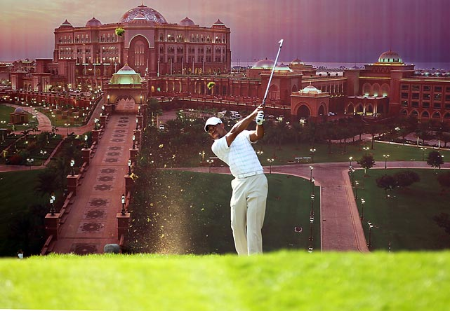 Backed by a poster of the Emirates Palace Hotel, Tiger Woods tees off during the second round of the Abu Dhabi Golf Championship. Woods finished in third place, his first tournament of 2012.