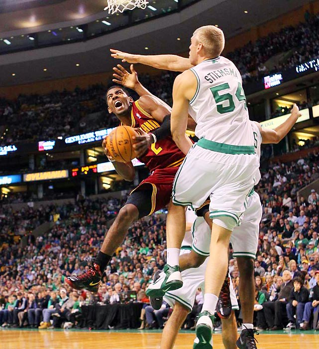 The No. 1 pick in the 2011 draft, Cavs point guard Kyrie Irving goes up for a shot against Boston center Greg Stiemsma.