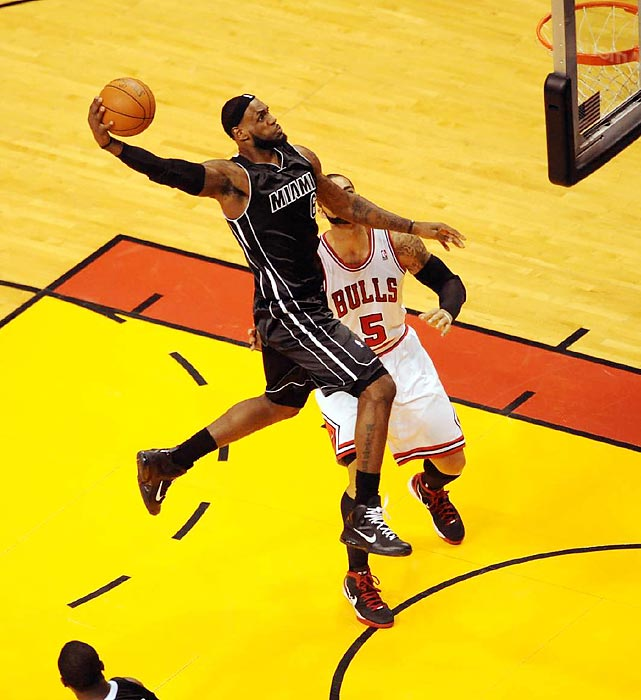 LeBron James soars for a dunk in the Heat's narrow victory over the Bulls.