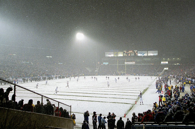 "The Patriots kick the ball off to the Raiders in snowy New England. The ""Tuck Rule Game"" was the last game ever played at Foxboro Stadium."