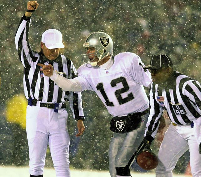 Raiders quarterback Rich Gannon complains to Coleman. The Oakland quarterback threw for 159 yards and a touchdown in the game.