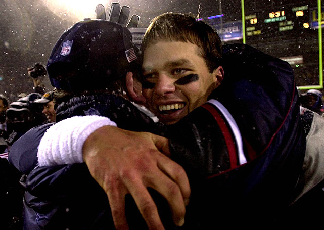 A youthful looking Brady hugs a coach following Vinatieri's winning kick.